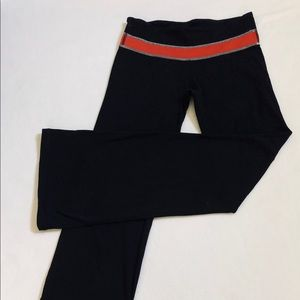 "Lululemon ""Groove Pant"", size 6 black w/red trim"